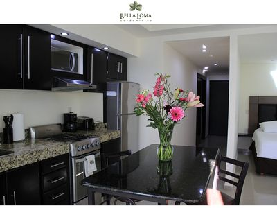 Photo for Well appointed condo, granite kitchen & balcony. 3 mins to beach and restaraunts