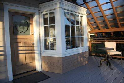 Covered front porch, dutch door opens for views and ventilation