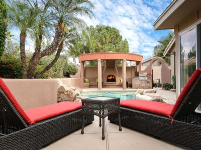 Photo for Home backyard Oasis with Putting Green, Pool, Fireplace, BBQ, & Waterfall - By PADZU