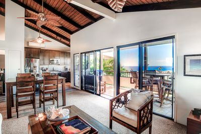 Open concept kitchen, dining, and living room with stunning ocean views.