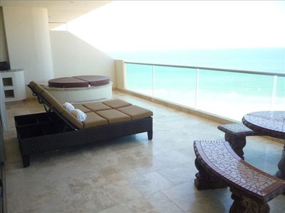 Spacious balcony w/ private hot tub, mosaic stone table, wet bar w/ grill