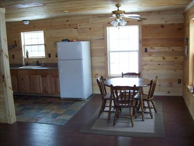 Cabin has beautiful wood floors and natural slate tile in the kitchen and bath.