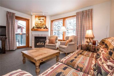 Living Room with Gas Fireplace and Patio Access