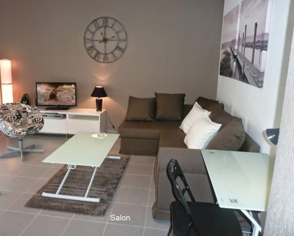 Location vacances appartement ovalie salon