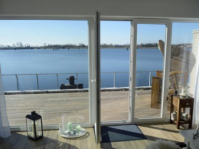 Photo for Modern apartment with sauna on the water ideal for couples and families