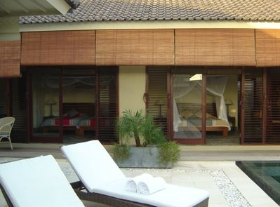 Patio sunbeds and view of both bedrooms