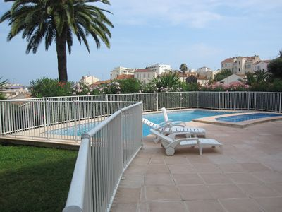 Photo for Big T2, central, terrace, clim, swimming pool, garage, Wifi
