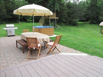 Backyard with deck, patio, hot tub, tree house and acres of beauty