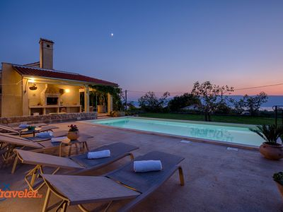 Photo for Romantic holiday home with pool, surrounded by beautiful nature with sea view