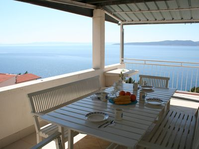 Photo for Stunning sea view from large dining terrace, 2 bedroom apartment