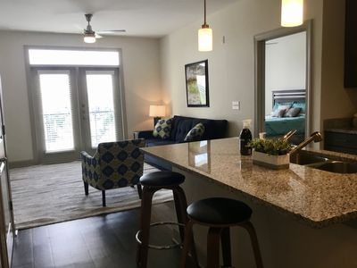 Open kitchen area with eat in island