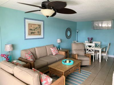Spacious Living/Dining Room with pullout sofa, large TV, A/C, oceanfront views