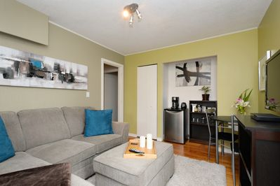Enjoy the cosy sitting room with bar fridge &  coffee nook in your private space