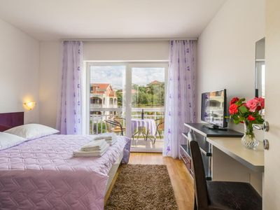 Photo for One bedroom apartment with balcony and sea view Trogir (A-15440-a)