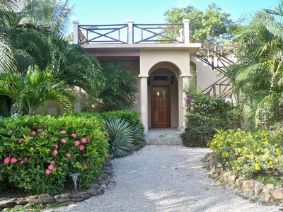 Lush landscaping delights the senses as you enter your vacation home!