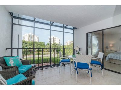 Screened in balcony with doors leading to living room and master bedroom.