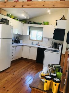 Summer Rest cottage kitchen with fridge, stove, dishwasher and microwave. Also griddle, waffle iron and crock pot.