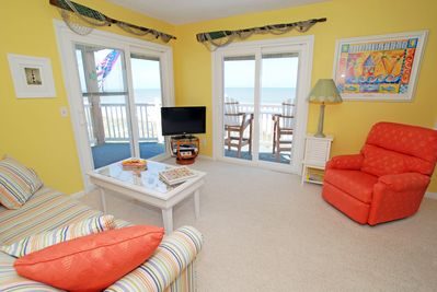Relax in the sun-filled living room with amazing views & deck access.