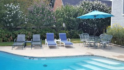 Plenty of seating-two patio sets and many loungers