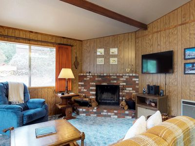Photo for Dog-friendly chalet surrounded by towering trees and hiking adventures