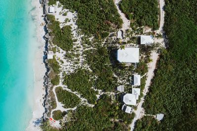 Over 1,000 feet of beach front over 4 acres offers unparalleled  privacy.