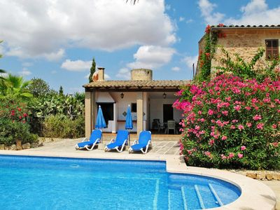 Photo for 4 bedroom Villa, sleeps 8 in Cas Concos with Pool and WiFi