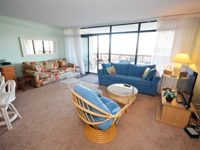 Photo for Spacious, comfortable 2 bedroom oceanfront condo with impeccable decor, free WiFi, an indoor pool, and an amazing ocean view located uptown and just steps from the beach!