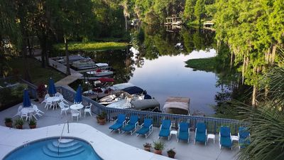 Photo for Relaxing River View with Balcony, Boat Slip, Pool, Hot Tub & Nearby Golf Courses