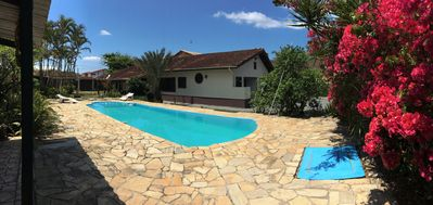 Photo for ITANHAÉM - 50m from the sea, ground floor with garden of 800m2, swimming pool and churraqueira