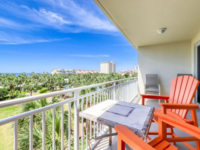 Photo for Relaxing private balcony condo, steps away from the beach w/shared pool