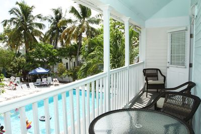Private balcony overlooking swimming pool. Nice table set for outside dinning.