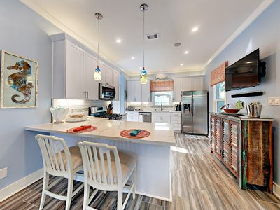 """Kitchen - There's comfy seating for 2 at the breakfast bar where you can also enjoy shows  on the kitchen's 42"""" flat screen TV!"""