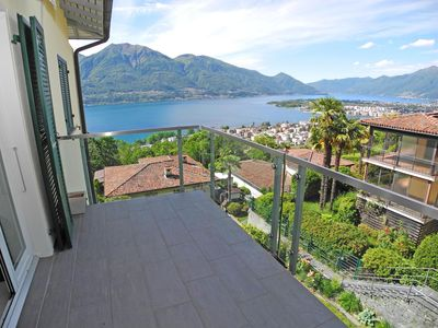 Photo for Nice and modern furnished 3-room apartment in Minusio, with fireplace, two Bal