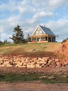 Photo for Ocean-front cottage on private, treed lot.