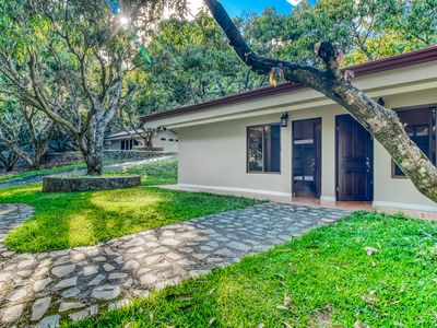 Photo for Comfortable cabin in gated community w/ shared pool, surrounded by gardens!
