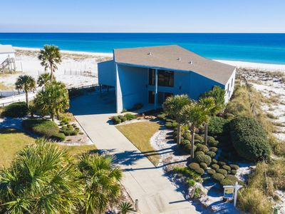 Photo for FREE NIGHTS THRU MAY 20TH! Cozy Gulf front home. Steps to beach! Sleeps 12