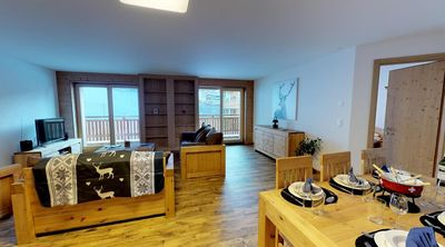 Photo for 4*, 2-bedroom-apartment, for 6-8 people right on the ski slopes. Modern and spacious living room wit