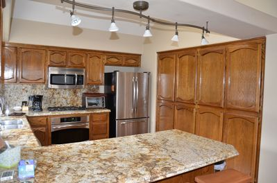 Updated granite kitchen with stainless steel appliances.