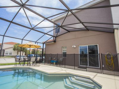 Photo for Four Bedroom w/ Screened Pool Close to Disney 4563