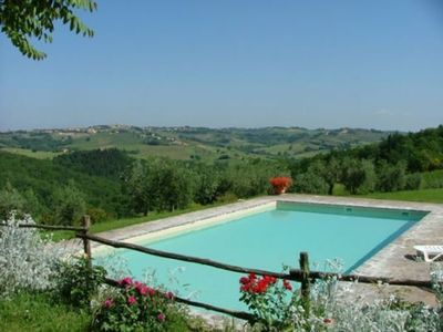 Photo for Cosy apartment with pool, TV, pets allowed, panoramic view and parking, close to San Gimignano