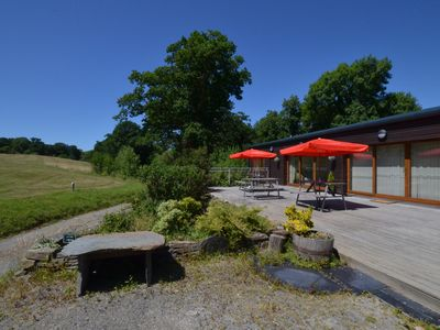 Photo for A single-storey contemporary lodge, one of three converted from the former club house at Dolgellau G