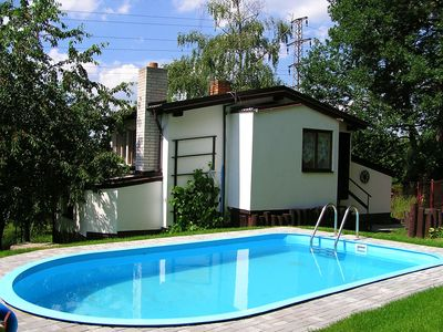 Photo for Holiday house with fireplace, outdoor pool and children's playground