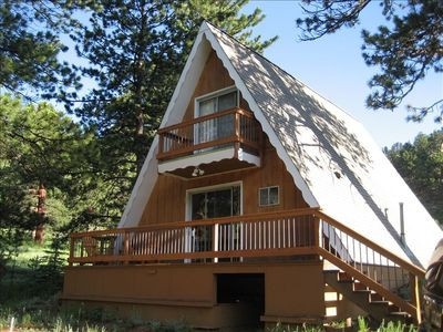 Outside front view of the A-Frame. Charm and comfort nestled in the woods!