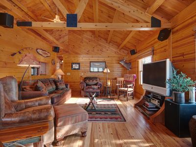 Photo for Quintessential lakefront log home w/ wood & gas fireplaces, firepit & views!