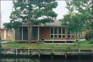 Photo for FREE DAILY ACTIVITIES!  Charming 3 bedroom, 2 bath beach cottage located on the canal with a dock.