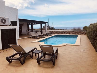 Photo for Villa Pura Vida on the seafront, private heated pool, air conditioning in all rooms, Wi-Fi and parking in front of the villa.