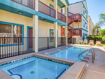 Photo for NEW LISTING! Updated condo w/shared pool & hot tub - one block to beach