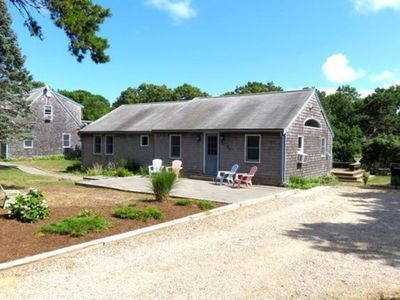 Photo for Sun-filled, renovated house within minutes walk to private bay sides beach.