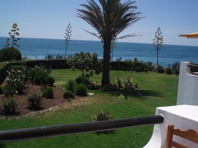 Photo for Villa Villa Charme, 1st floor, next to the sea, overlooking the beach of fine sand.