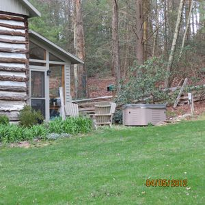 This is a rear view of the kitchen and the flagstone patio. Hot tub on right.